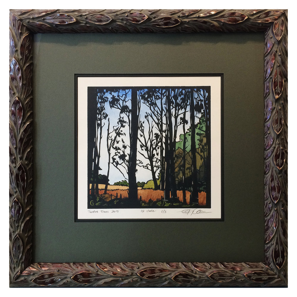 This wood block landscape print was framed in a beautifully detailed silver and black acanthus-leaf moulding.