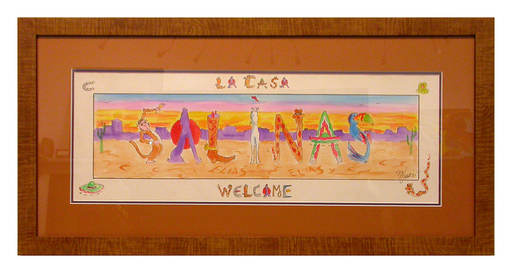 A Southwest-themed print intended to welcome guests into the home. The rustic wood frame and leather-colored mat complete the design.