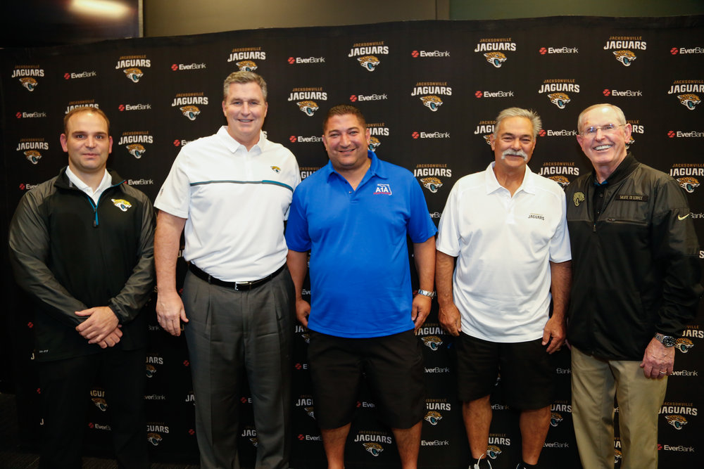 Jacksonville Jaguars Tom Coughlin and Coach Doug Marrone with A1A Investigators
