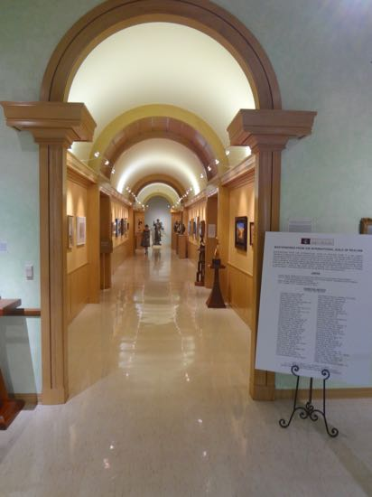 museum interior with arched hallway