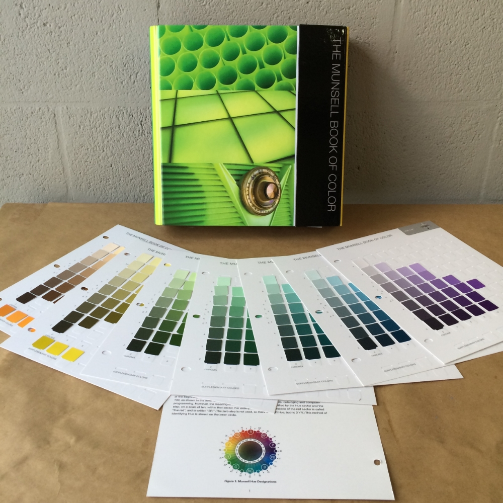 The Munsell Book of Color (Glossy Edition) and a few of the internal pages of color chips.