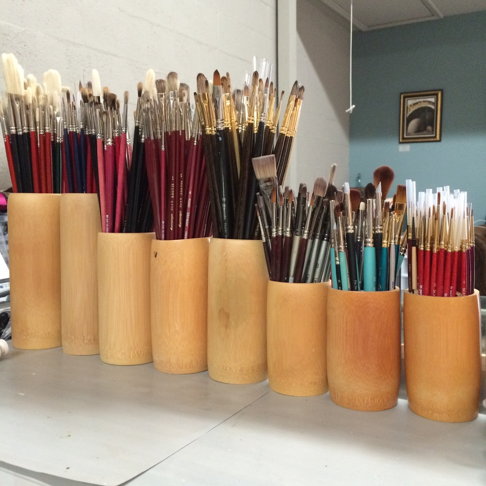 bamboo jars of brushes