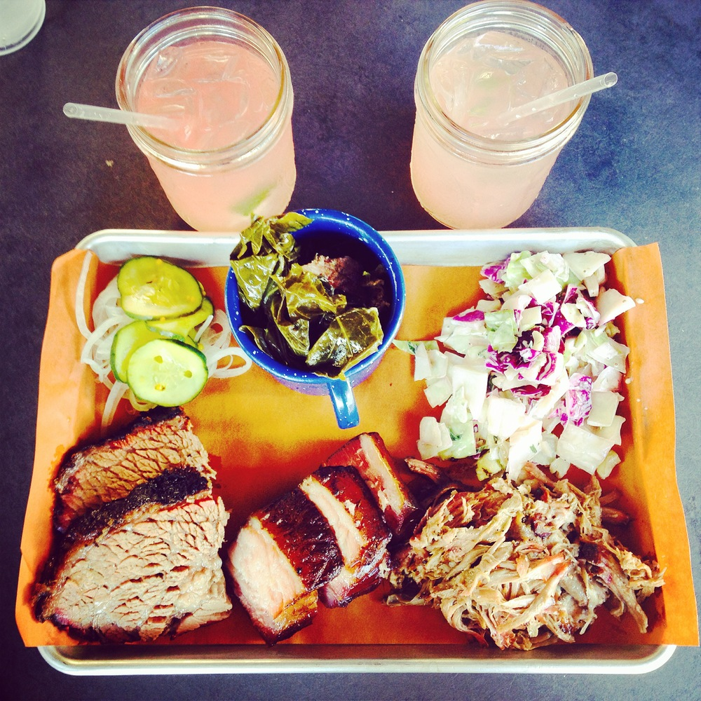 Fat Cheeks Tray with berkshire pork belly, berkshire pulled pork and great northern brisket served with coleslaw, collard green, pickles and onions.