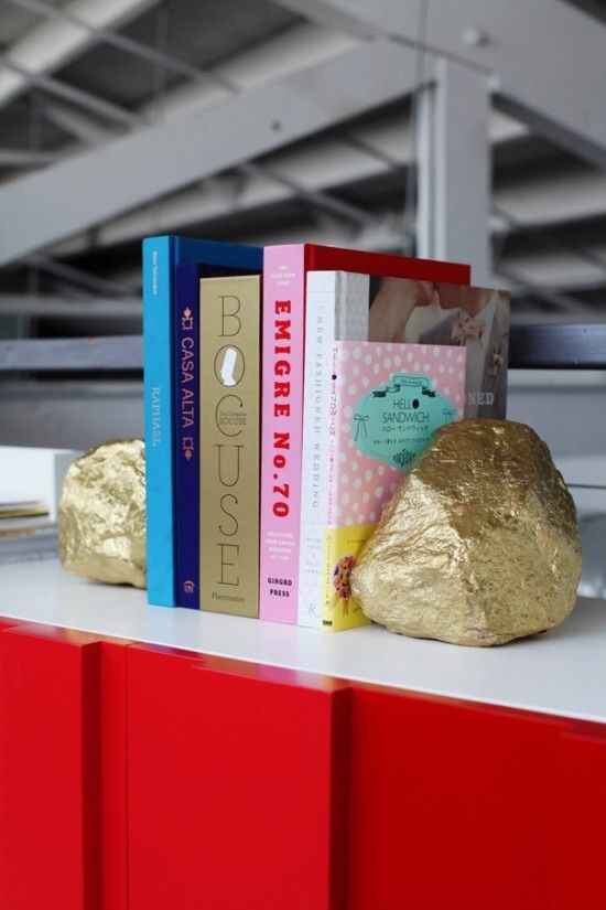 Fun bookends! Spray paint some rocks gold!