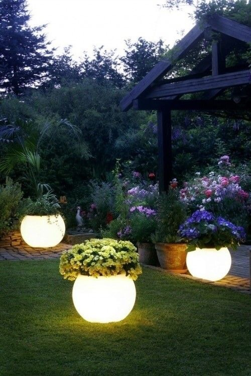 Love this! Painted pots with glow in the dark paint!