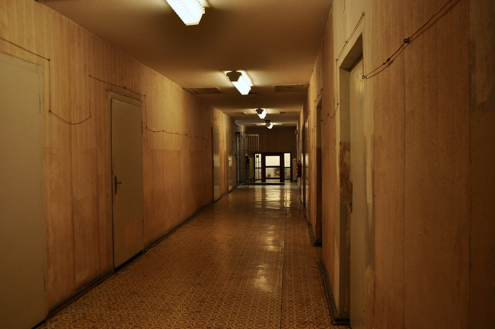 The corridor between the interrogation rooms - each door was designed to look the same to purposefully confuse the inmates and make them feel disorientated.