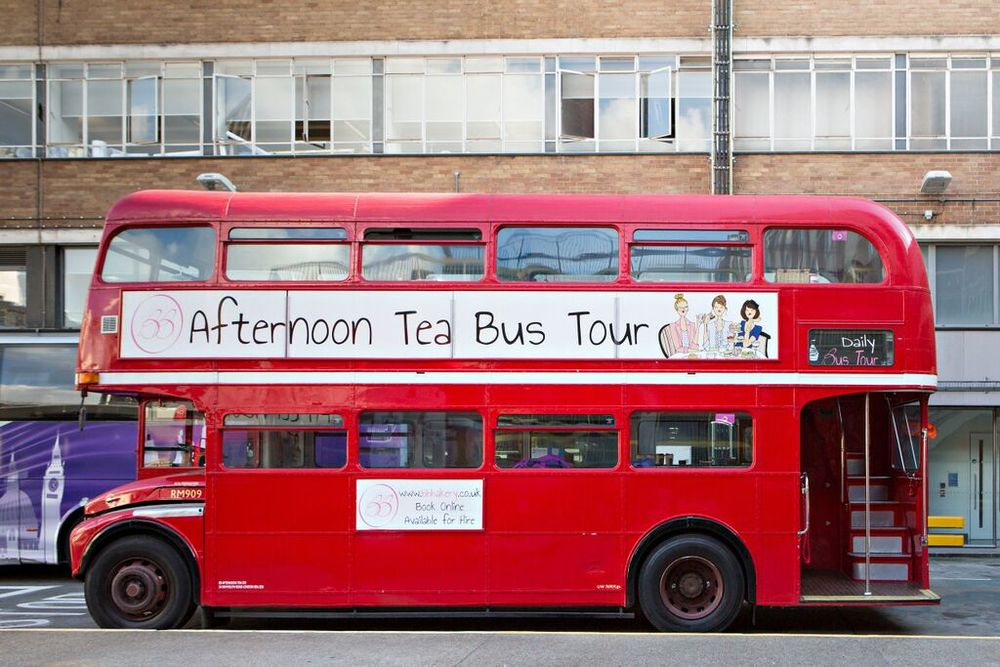Our Vintage Red Bus that we boarded for our afternoon of foodie delight. All abord! - (Image by Friends of Glass)