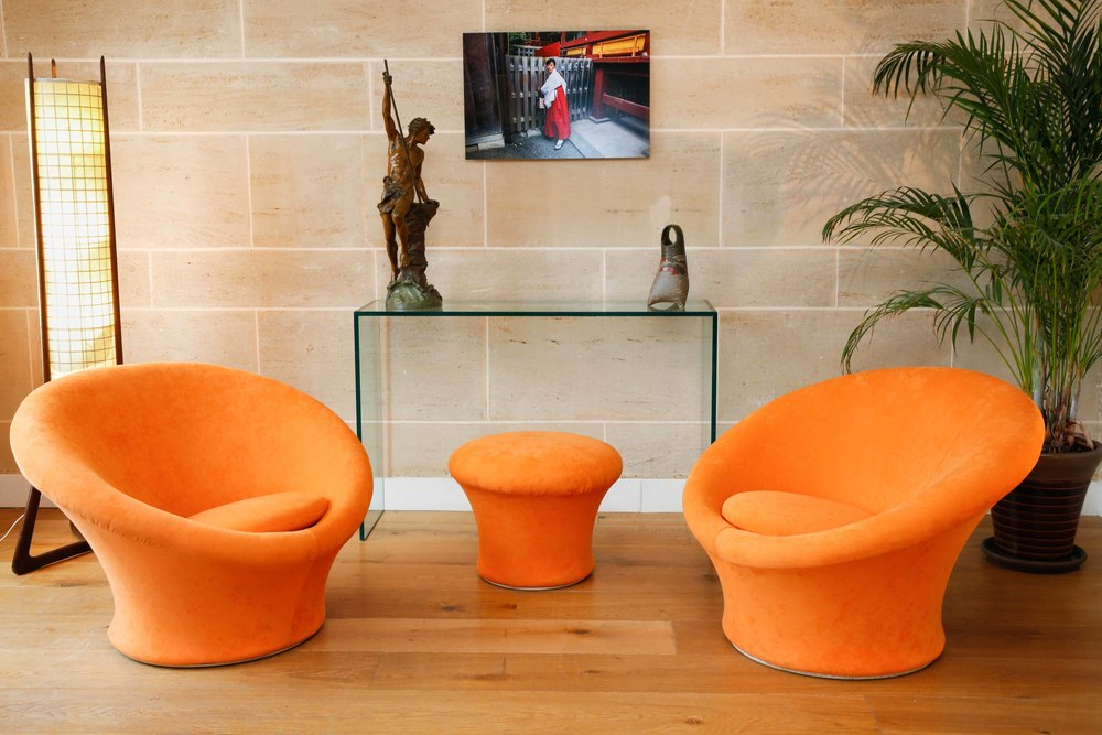 A Mushroom set composed of two armchairs and an ottoman. Designed by Pierre Paulin.  Edited by Artifort.