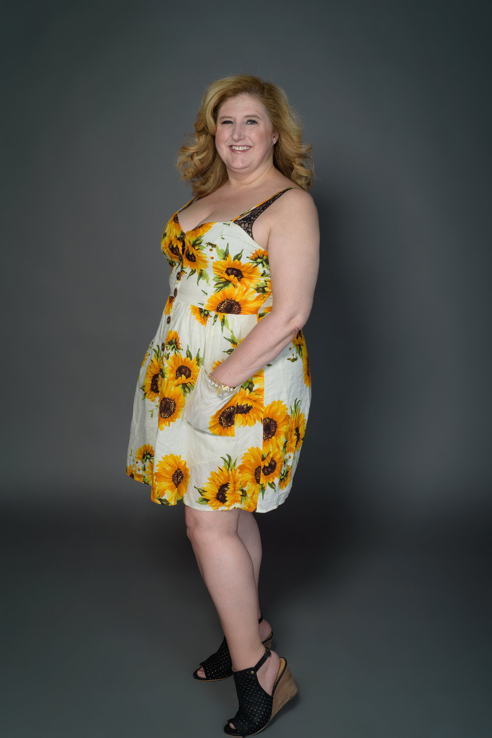 pocket full of sunshine dress  - We're in love with this sunflowered dress and it's big brown buttons going down the middle. Also, ONE WORD: POCKETS!!!