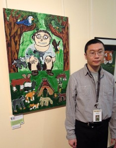 Jimmy Shum next to his work 'Jimmy is Sitting'
