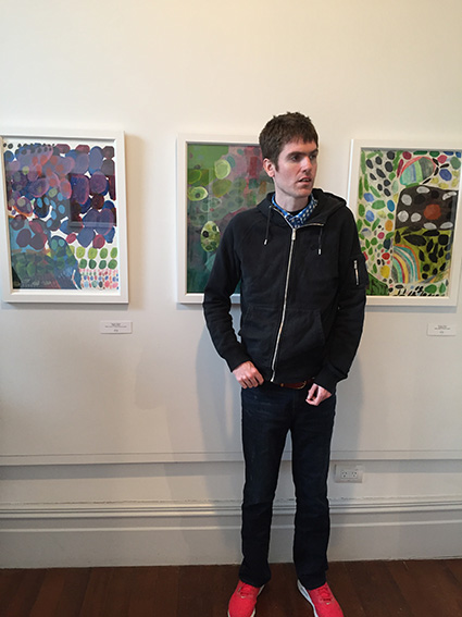 "Matthew Allerby at the ""Good Shapes"" Exhibition Opening with some of his artwork"