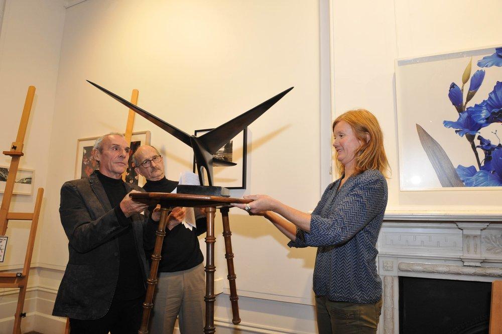 Māpura Studios art tutors Ian Moore (left), Jim Flewitt (center) and Cath O'Brien (right) with Fred Graham's  Night Hawk .