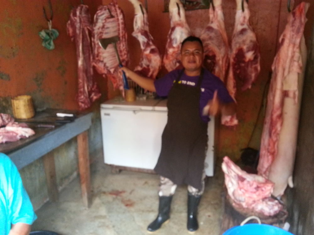 Local butcher enjoys his work...