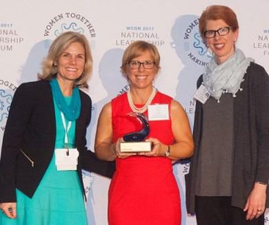 Former Womenade Boston President Christine Swistro, center, receives the Spotlight Award in Jacksonville.