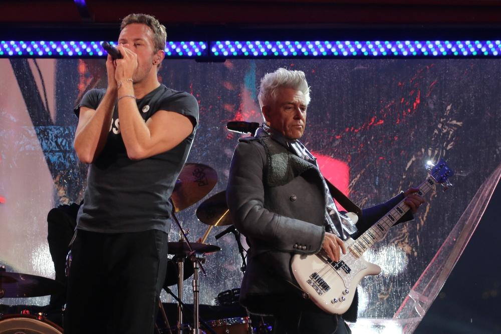 Chris Martin and Adam Clayton