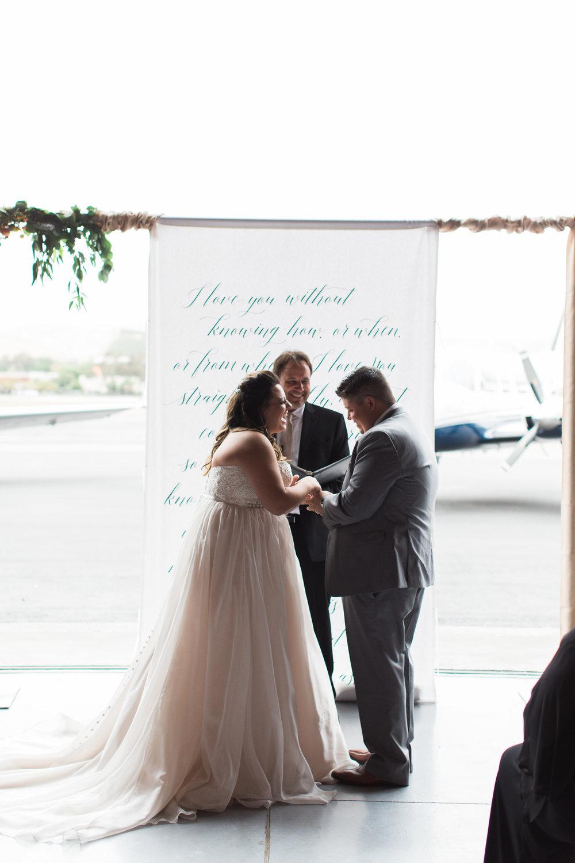 airport-hanger-wedding-at-attitude-aviation-in-livermore-64.jpg
