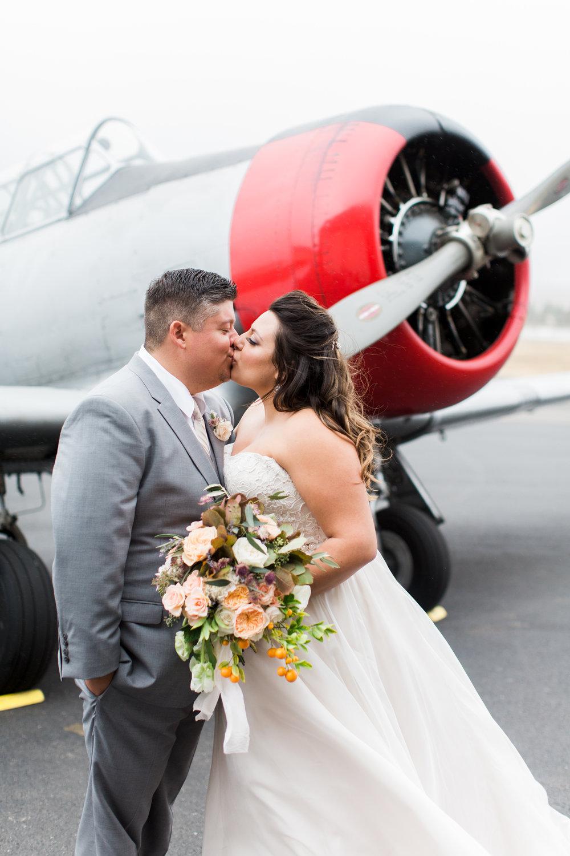 airport-hanger-wedding-at-attitude-aviation-in-livermore-75.jpg