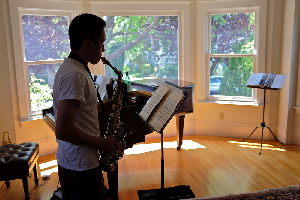 """A high school student plays during a private lesson at """"The Lesson House."""""""