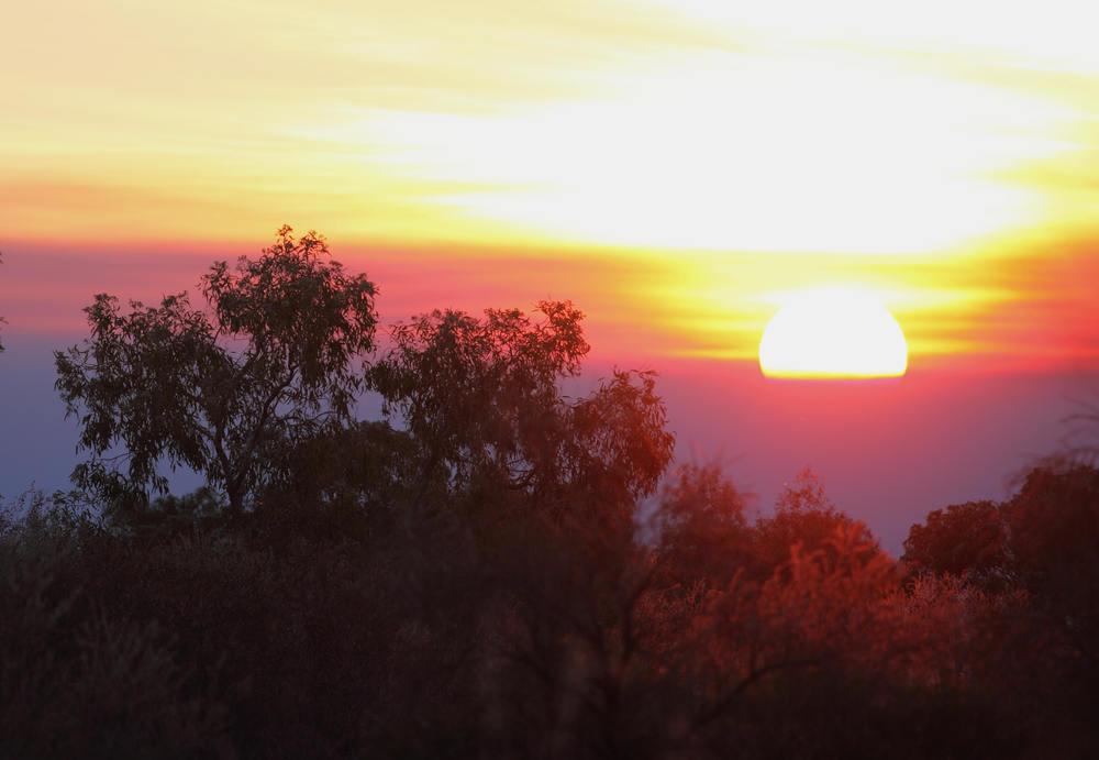 Sunset over the Wakaya Desert, Northern Territory in the vicinity of the report. A varied landscape.