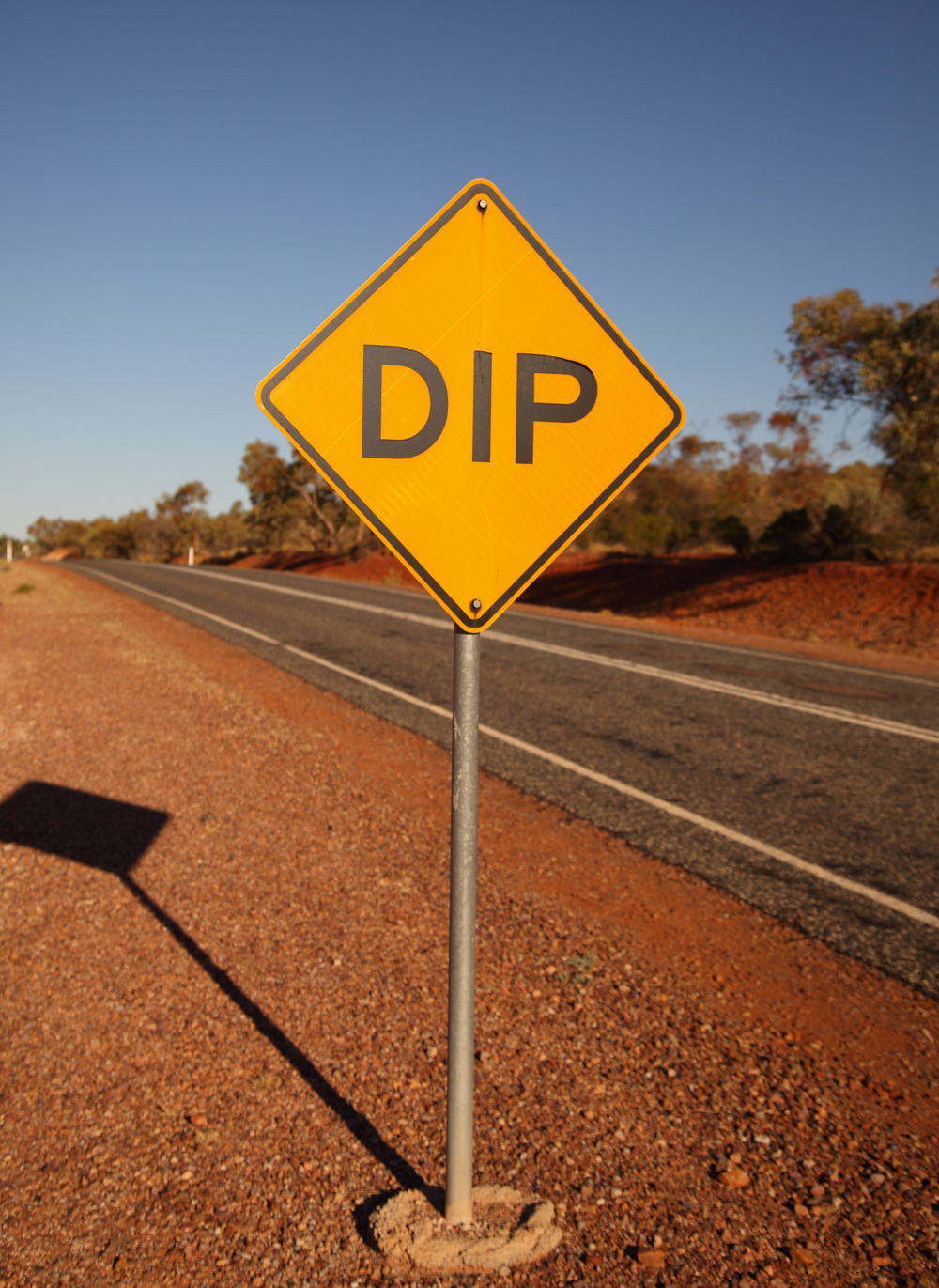 The stark honesty of outback road signage.