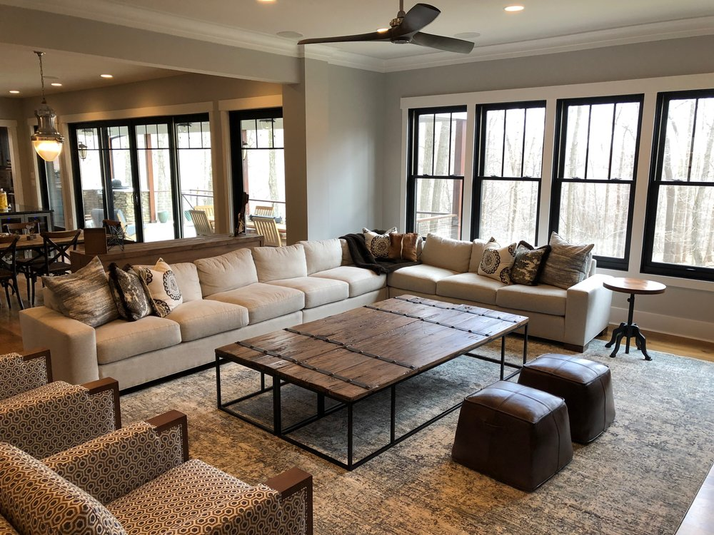 Family room with an oversized couch and coffee table.