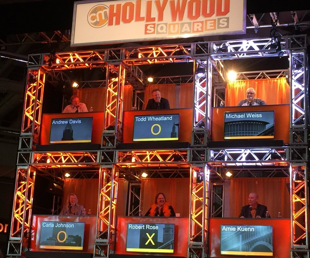 Content aficionados comparing knowledge during CMW2016 Hollywood Squares