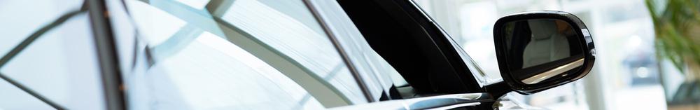 stock-photo-modern-expensive-black-car-in-the-showroom-141171874.jpg