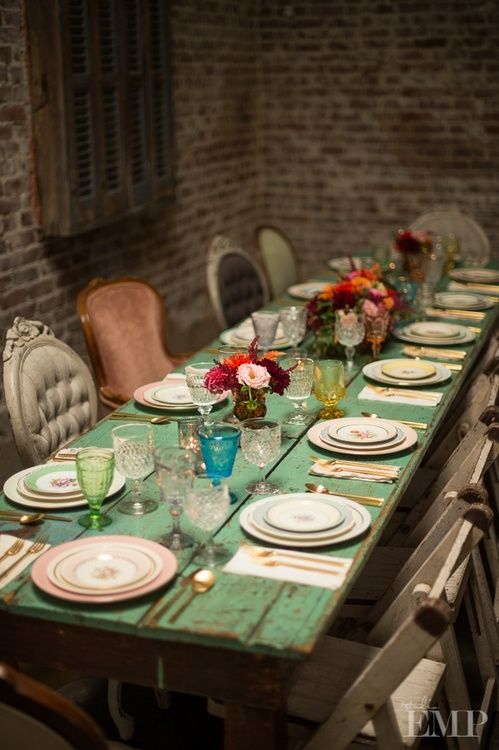Throw a fun dinner party - use old china and glassware and mix & match chairs to achieve this look. (Image from berengia.tumblr.com)
