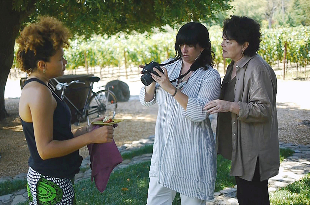 Jennifer Barry   (far right)   art directing a cookbook with photographer Leslie Sophia Lindell. Photo by Kim Thompson Steele