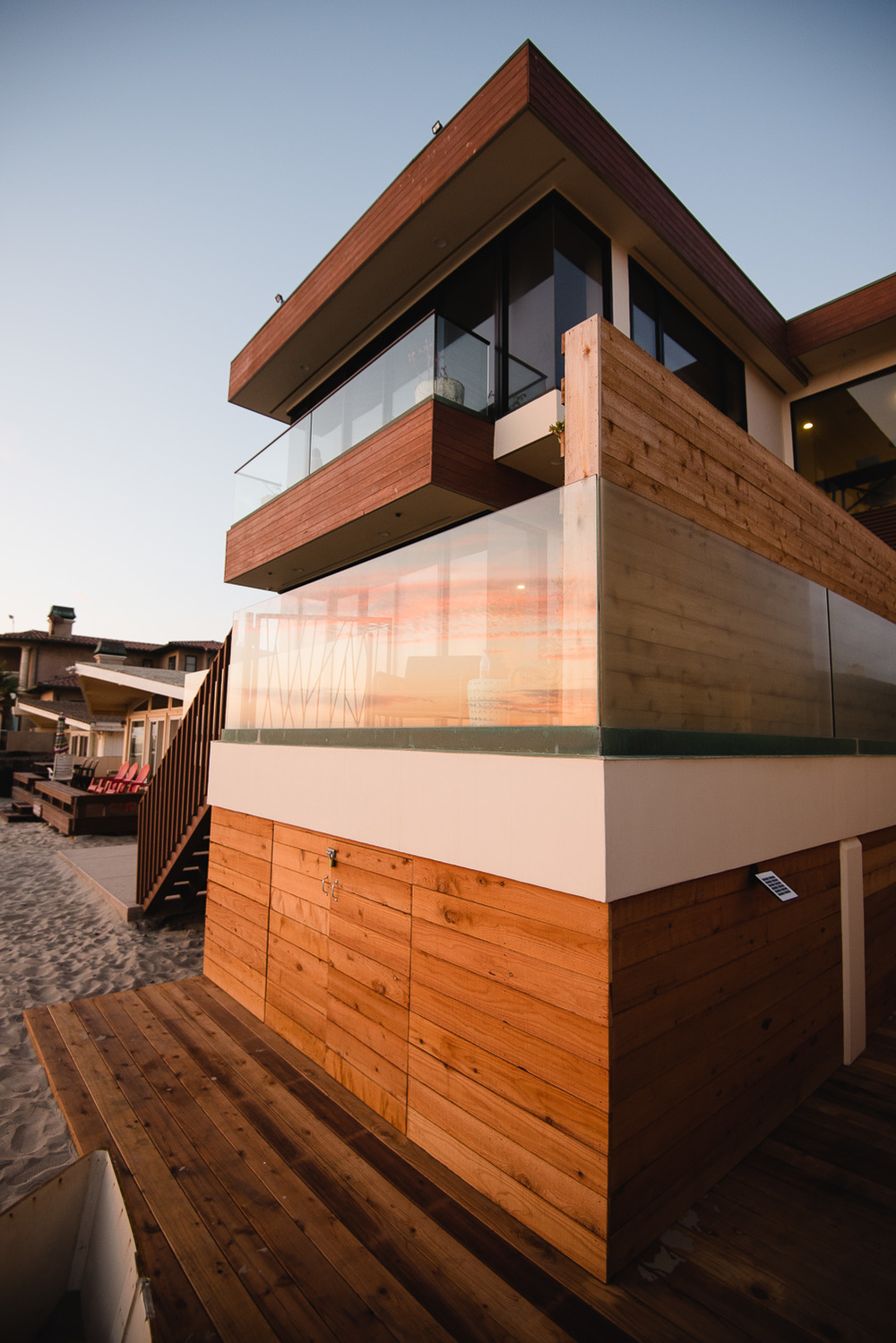 A FEW TWEAKS Levi turned the open space beneath the house into a sleek surf shack with a wraparound walkway.