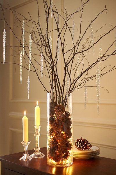 DIY that's actually doable. Lights, pine cones, branches, and you're done. Apartment Therapy