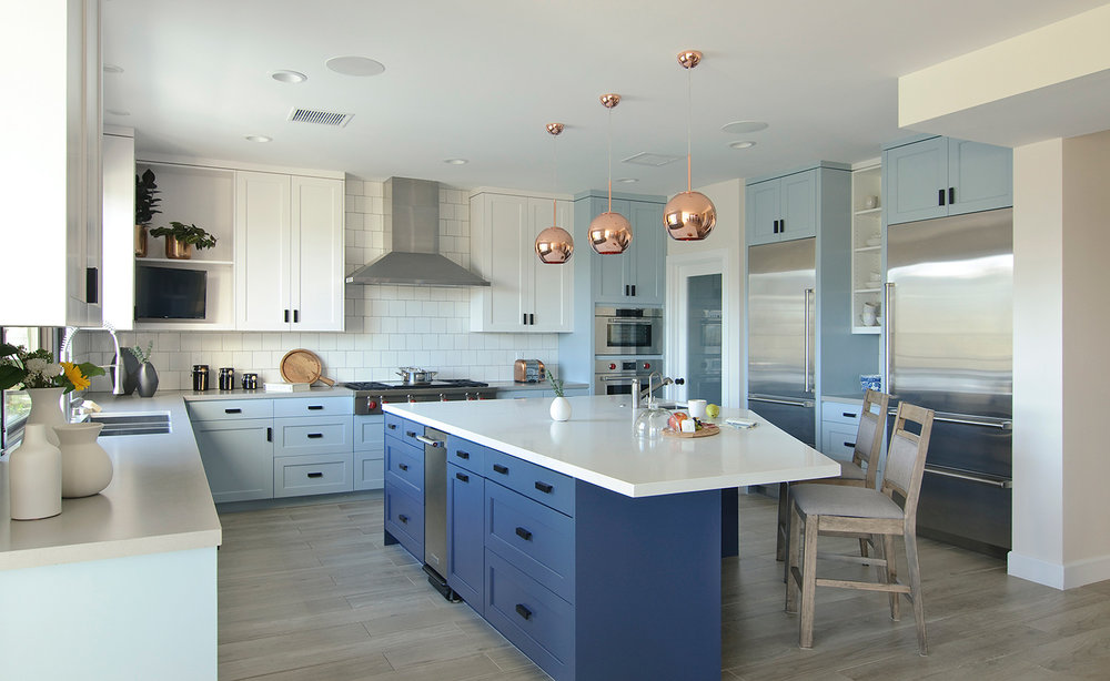 CENTRAL HUB  Clean shaker cabinetry in playful colors, endless storage, and a generous island turned this kitchen into the heart of the home.