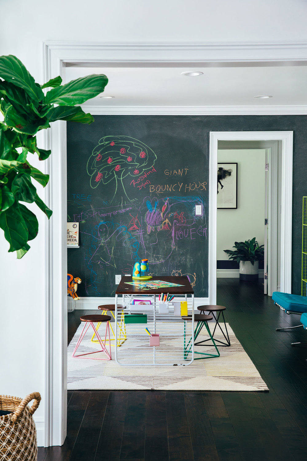 LET'S PLAY  Chalkboard walls and a generous crafts table means low-tech fun all day.