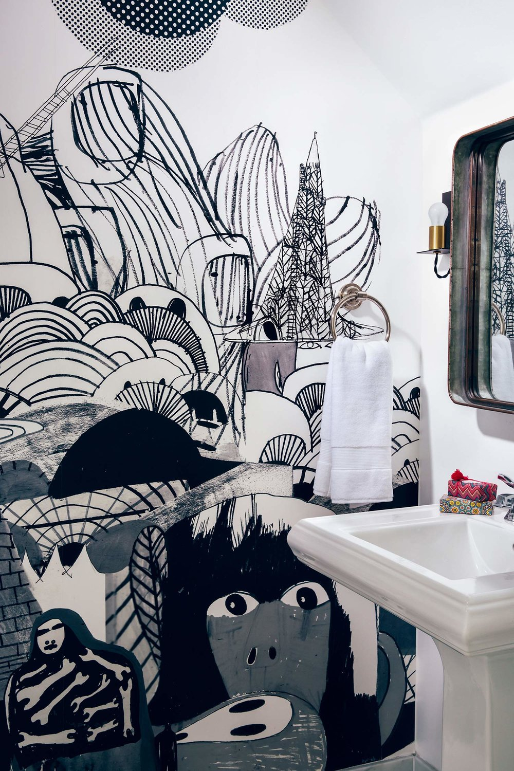 WHAT'S BLACK AND WHITE AND COOL ALL OVER?  A floor-to-ceiling graphic mural from Paris transformed this unassuming powder room.
