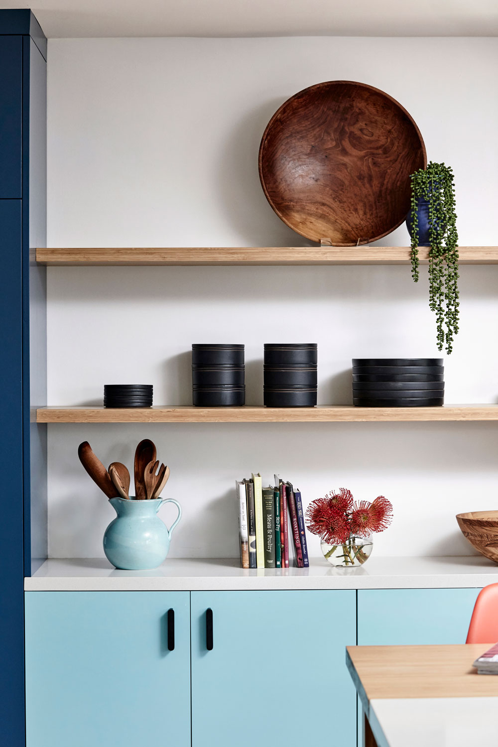 Open-shelving and a buffet perfect for parties that (always) end up in the kitchen made this much more than a colorful statement wall.