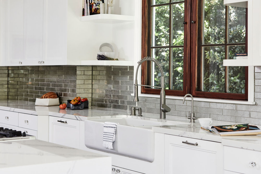 These antique-mirrored glass tile from Ann Sacks were a perfect material to bridge our modern meets classic look.