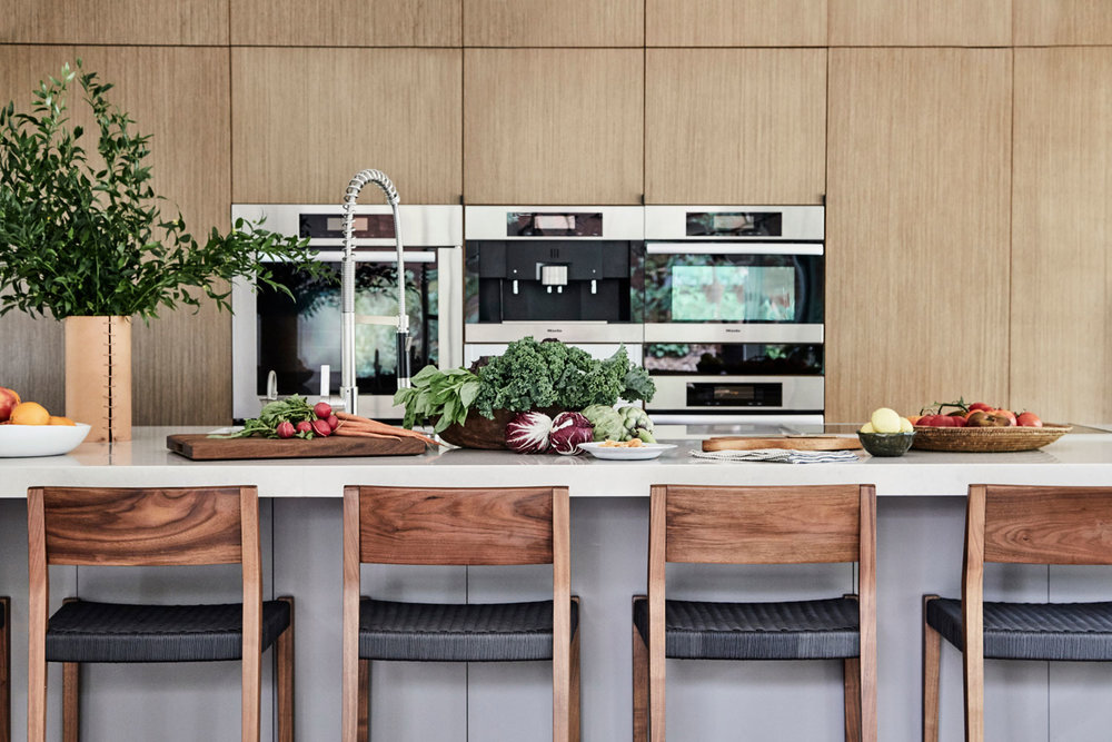The refined rustic feel of these counter stools adds needed texture to the clean lines of this kitchen.