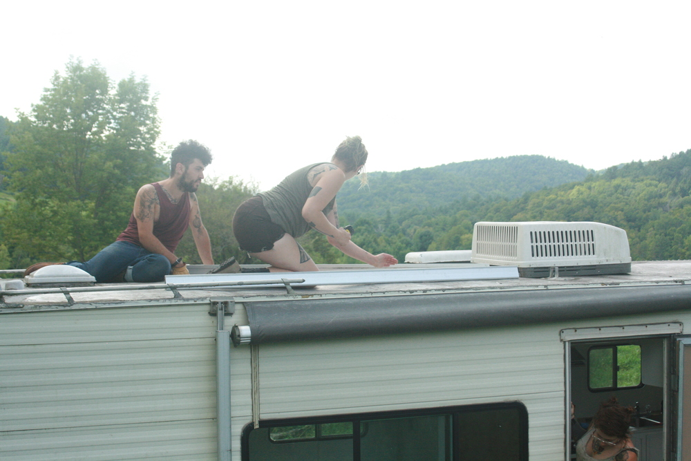 photo by noel'le longhaul  solar panels!  are close but not done.  i swear it'll happen soon.  i'm always one tool short.