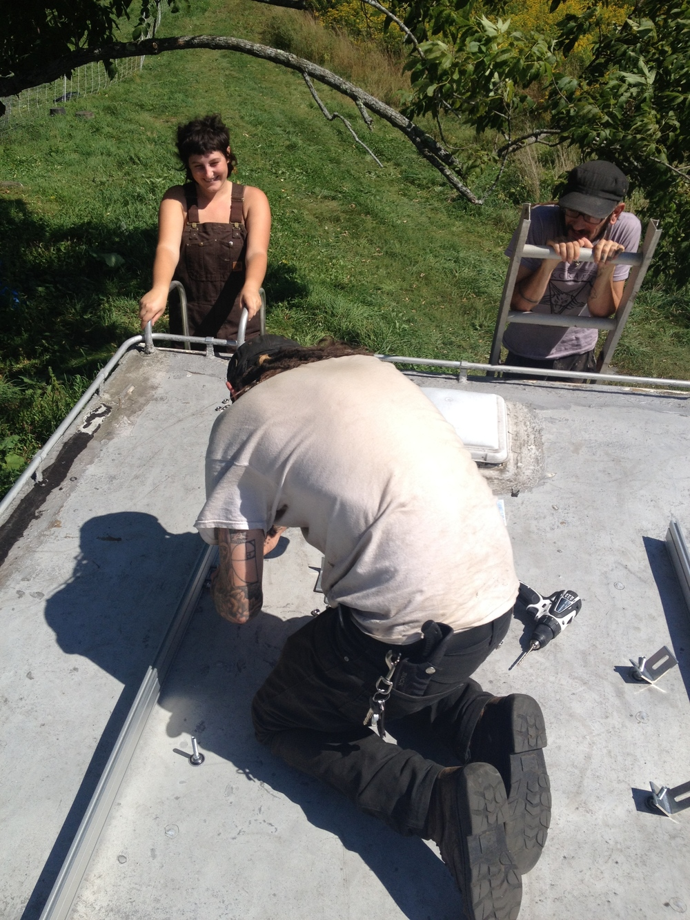 travis and i were on the roof assembling while emma and wally hung out on the ladders.  wally made a good joke about how it felt like a city job, two people working, two people watching.