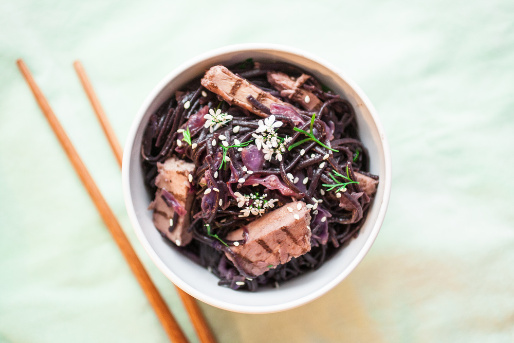 Produce On Parade - Thai Purple Pasta - A beautiful purple pasta with sauteed red cabbage and plant-based meat, laden in a sweet, Thai sauce.