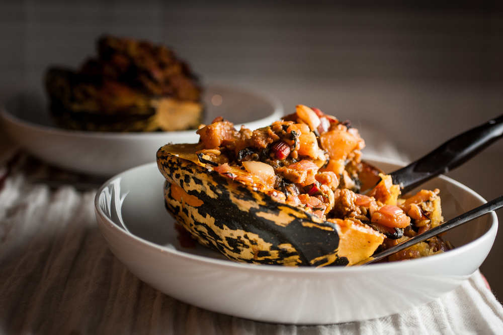 Produce On Parade - Stuffed Sage Carnival Squash - This is an easy and impressive festive squash stuffed with apples, kale, pumpkin, and vegan sausage. It's the perfect star or companion of any Thanksgiving dinner.