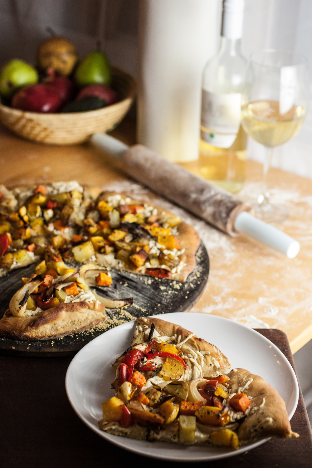Produce On Parade - Roasted Squash and Vegetable Pizza - Roasted squash, sweet potato, carrots, and other assorted vegetables adorn a sweet and doughy homemade pizza crust with creamy, vegan mozzarella.