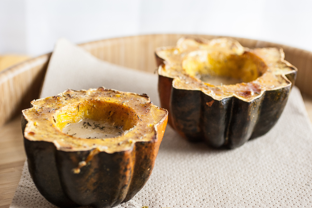 Produce On Parade - Eggnog Roasted Acorn Squash - A delicious, versatile, and easy way to use up extra squash. Serve with dinner, or as dessert! With creamy eggnog and caramelized brown sugar, these thyme scented squash are sure to be a hit!
