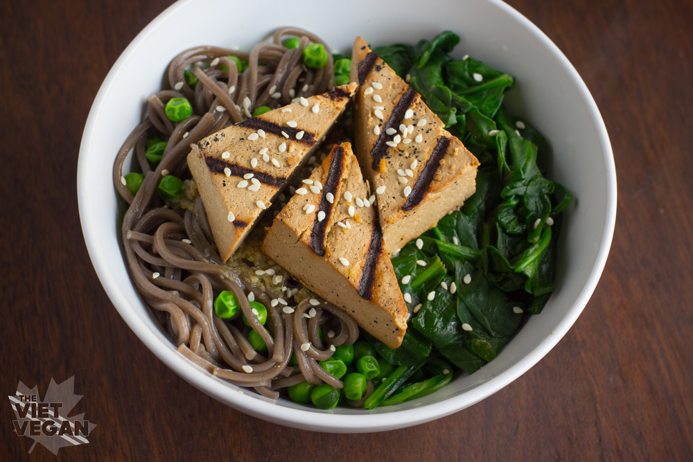 From The Viet Vegan - Grilled Tofu Soba Noodle Bowl with Greens - A warm bowl of grilled, marinated tofu atop soba noodles with spinach and edamame.