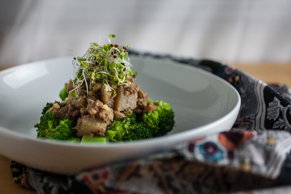 Produce On Parade - Agave & Miso Braised Turnips with Steamed Broccoli - Sweet and meaty turnips are braised with TVP and walnuts in agave nectar and washed with miso. Perched atop a bed of steamed broccoli and topped with sprouts, you can feel good about this unique and delicious meal.