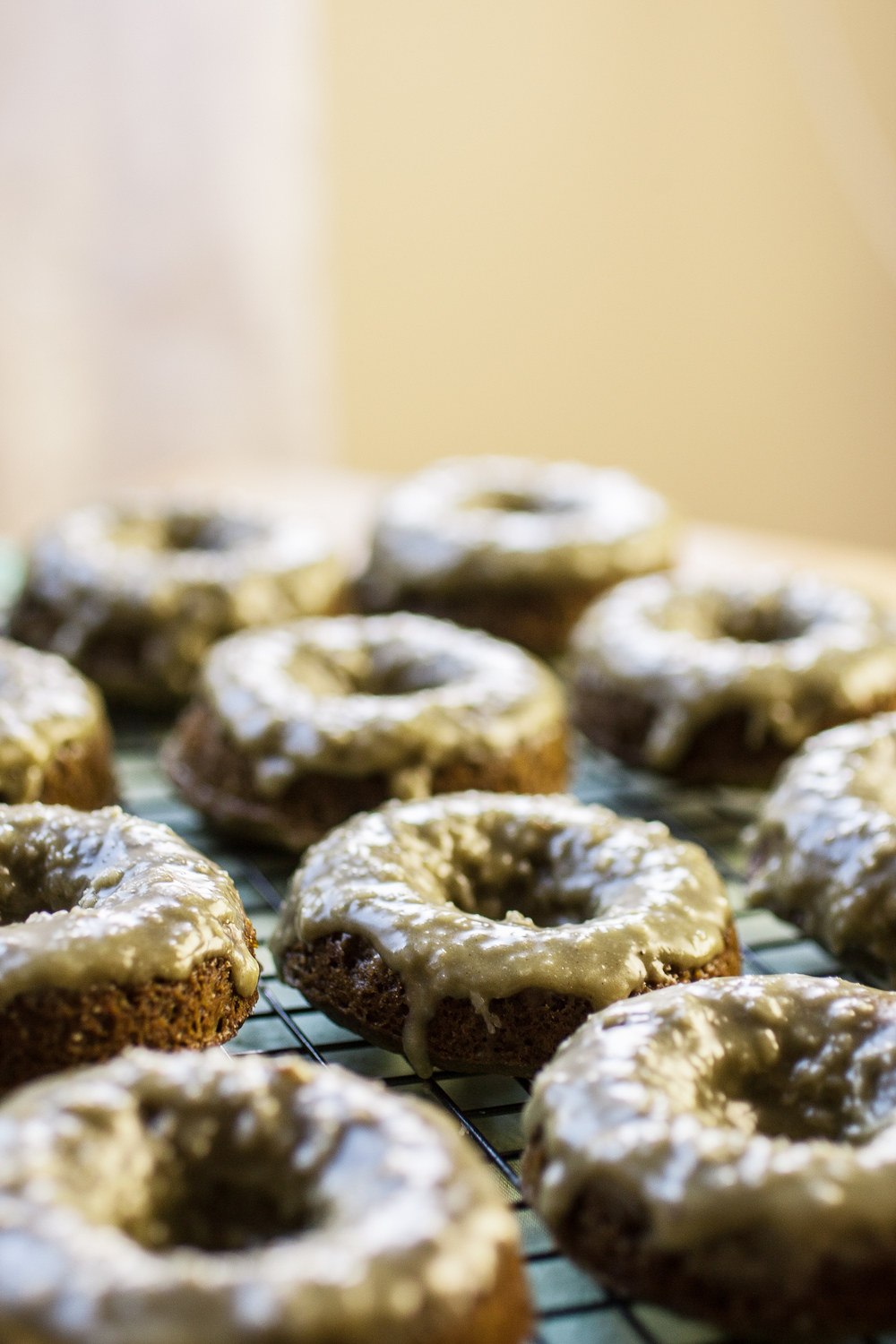 greenteadonuts (10 of 13).jpgProduce On Parade - Green Tea Doughnuts w/ Crunchy Coconut Glaze - Baked doughnuts with powdered green tea mixed right in the batter! Adorned with a sweet and crunchy coconut-nutmeg glaze, these are easy to make and brimming with green tea flavor. A perfect and unique treat for St. Patrick's Days!