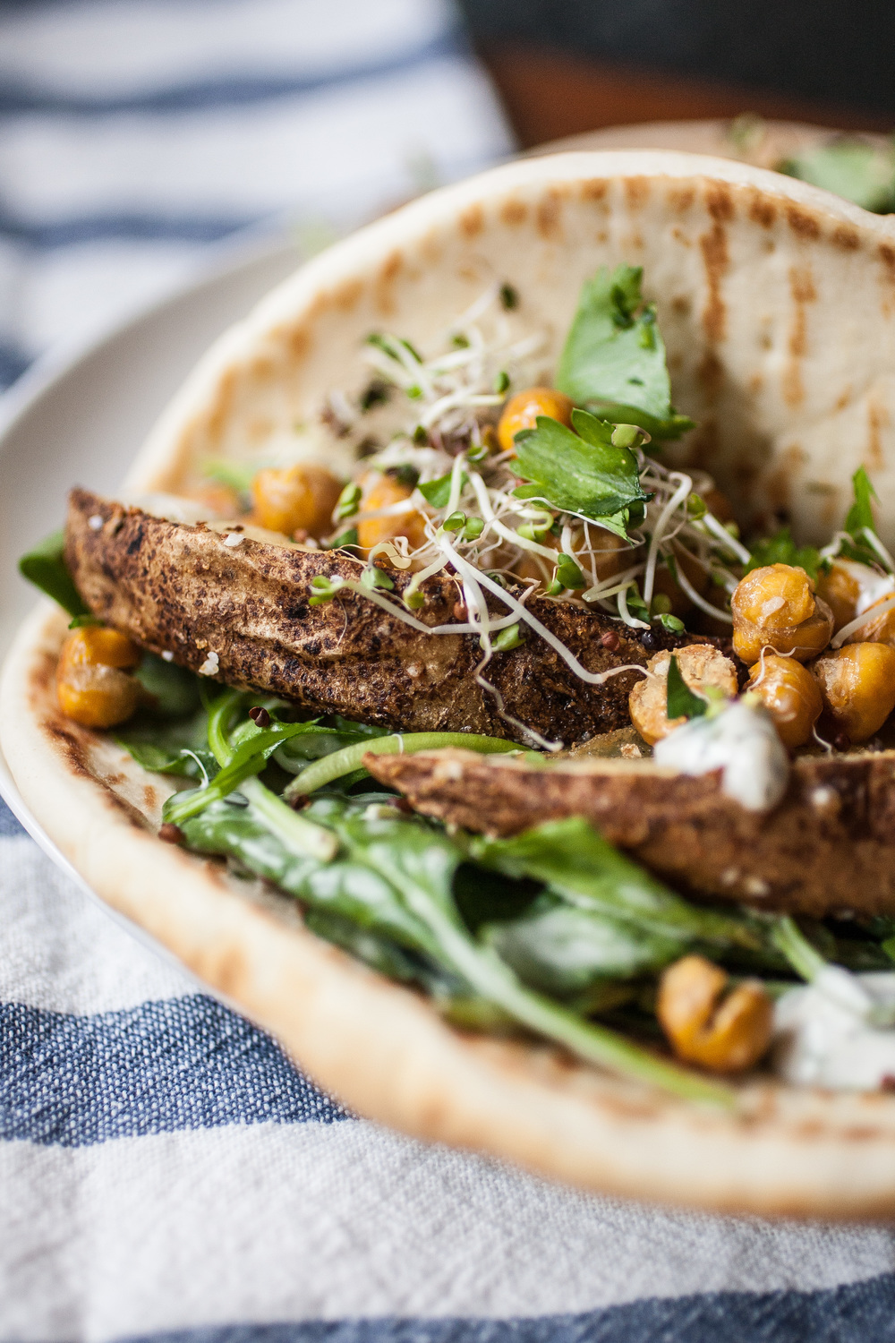 Produce On Parade- Ranch Pitas w/ Roasted Potatoes & Chickpeas - This is a super easy and perfect way to use up those russet potatoes you found in the back of the cupboard that might have started sprouting (guilty!) The roasted chickpeas add a wonderful little crunch, and the homemade ranch dressing lends a nostalgic creaminess, all cozied up in a soft, warm pita!