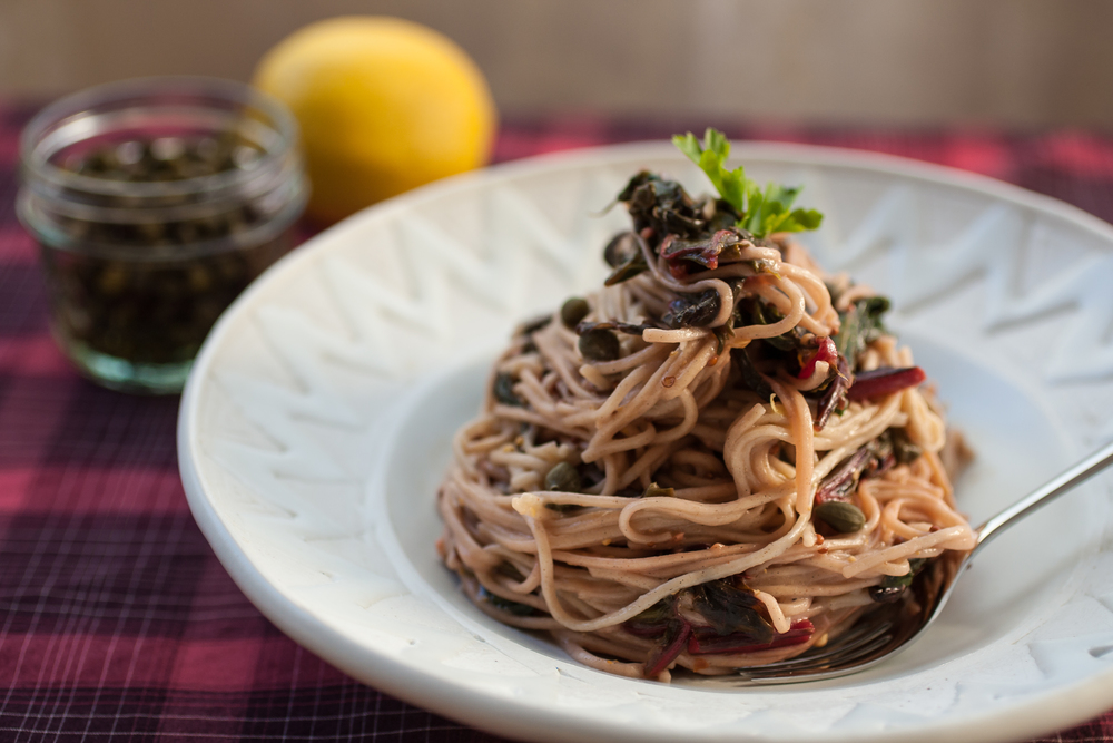 Produce On Parade - Lemony Chard Soba Noodles - These soba noodles are dressed in a zingy lemon sauce, tangled with wilted chard and beet greens and studded with sour and salty capers. A perfectly light, spring-time meal that's ready in a flash.