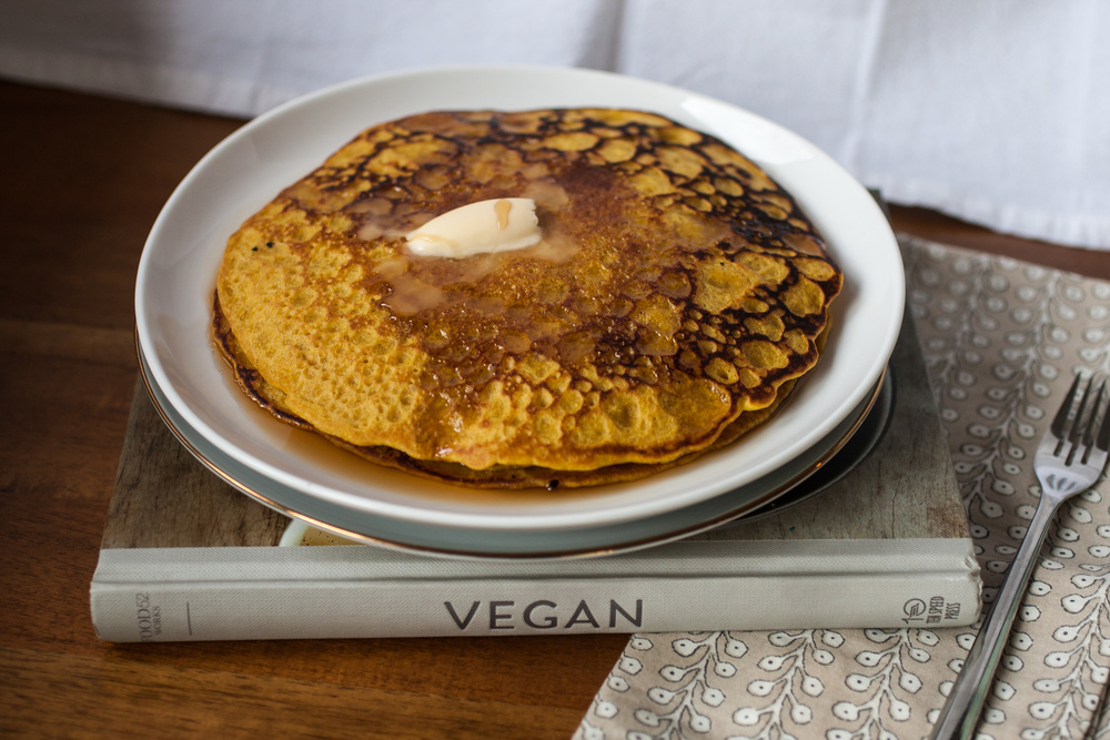 Produce On Parade - Turmeric & Cinnamon Pumpkin Pancakes and Food52 VEGAN Cookbook Review -These light and fluffy pumpkin pancakes are spiced with cinnamon and turmeric for a seasonal flair and a boost in antioxidants. A two-bowl recipe that's about as easy and quick as they come! Vegans and omnivores alike will agree this breakfast is a keeper.