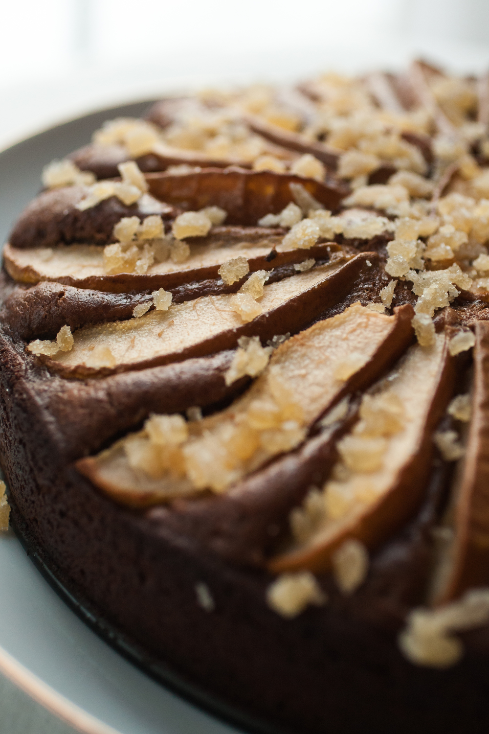 Produce On Parade - Molasses & Pear Gingerbread - This moist gingerbread cake is perfectly spiced and reminiscent of the holidays. Infused with molasses, nutmeg, and ginger with just the right of amount of sweetness and topped with sliced pears and candied ginger pieces, it's super easy to make and is sure to be loved by all.